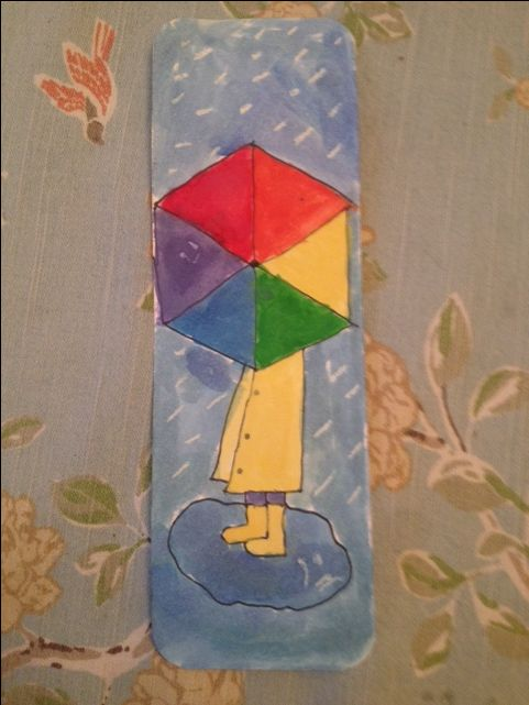 Umbrella and rain watercolor resist art a a bookmark (we used a plastic food lid to guide the circle, then a ruler to divide the circle, then a ruler to connect the lines as triangles; younger students will find it easier to divide into 8th).