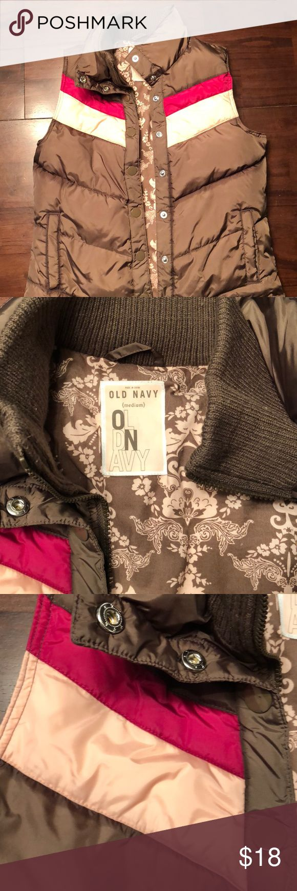 Women's Puffy Vest Size Medium Old Navy Chocolate color with peach and fuchsia strips. Super cute inside lining! Inside zipper works great. Sweater material on the neck for added warmth. Love it but too small for me. Old Navy Jackets & Coats Puffers