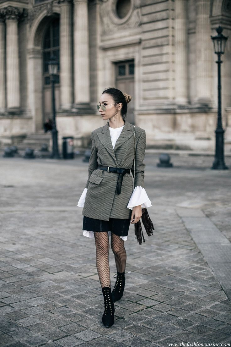 Fashion blogger Beatrice Gutu wearing Extreme bell sleeves with belted checked blazer and black mini skirt with fishnet tights fall trend 2016 during Paris Fashion Week