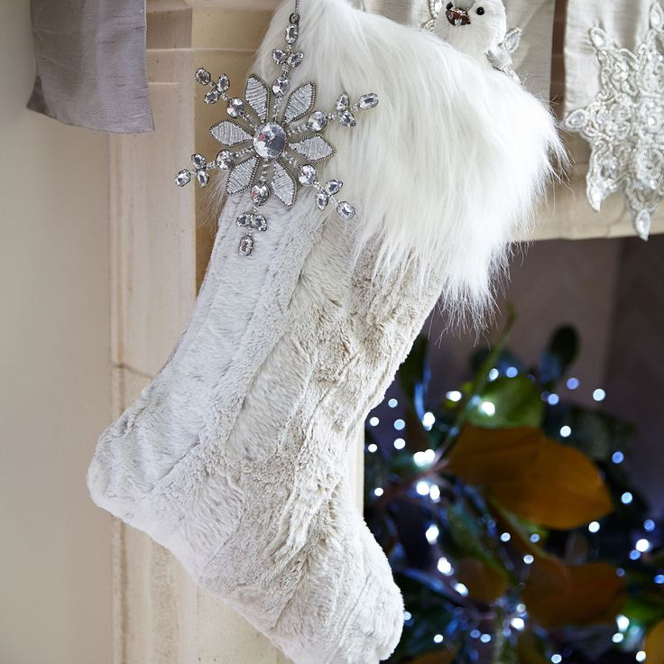 On the prowl for a new, more fashionable stocking? Consider our plush, printed snow leopard option. It's super-soft, extra-roomy and features a fuzzy cuff. Coordinates with our Snow Leopard Faux Fur Tree Skirt (sold separately).