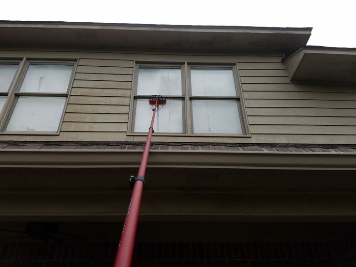 Cleaning second story windows without a ladder cleaning
