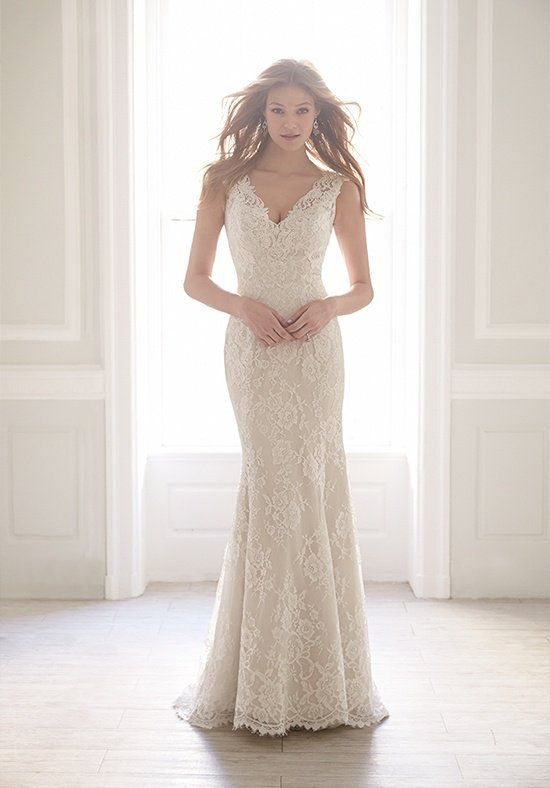 Float down the aisle in this creamy lace sheath gown.