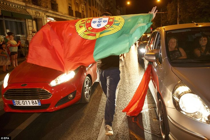 Celebrations of Portugal's win stretched as far as Geneva where this fan took to the middl...
