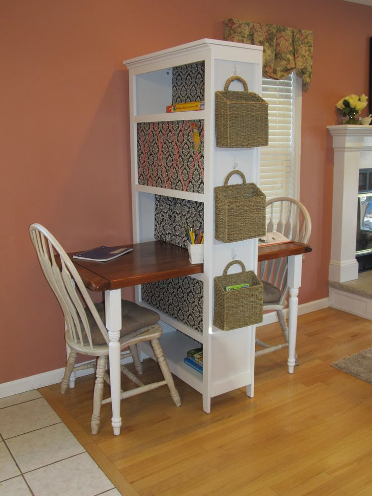 Two person desk. Bookcase, repurposed coffee table top and table legs from home depot.  Great homework station.