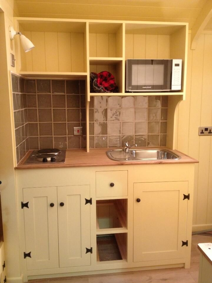 Micro kitchen in a Plankbridge shepherd's hut. Bespoke shepherds' huts made by craftsmen in Dorset UK.