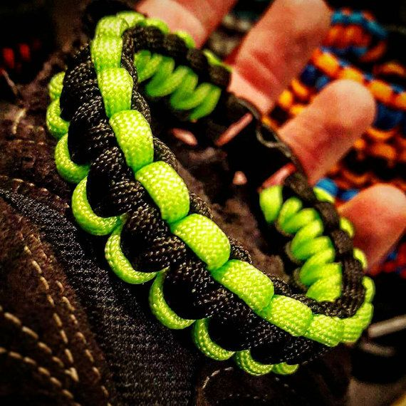 Check out this item in my Etsy shop https://www.etsy.com/listing/289762643/black-neon-green-cobra-paracord-bracelet