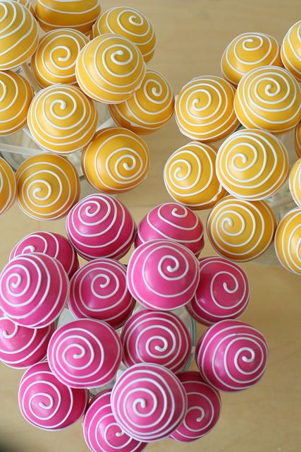 Yellow and Pink Swirly Cake Pops by Sweet Lauren Cakes, via Flickr. Change the pink to grey and you've got me sold!