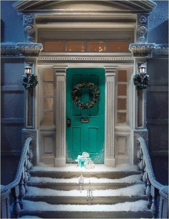 The sturdy stair rails, the side pillars, and the Tiffany blue front door -- love it!