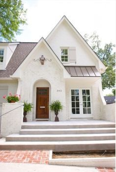 """What's not to love?!? While some styles are trendy or """"hip"""", I truly feel that white painted brick is something I would NEVER tire of. Add a warm gray trim, a spacious front porch…"""