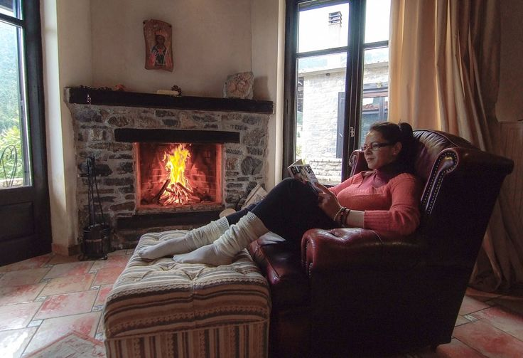 Ostra Menalon Luxury Suites Woman relaxing fireplace