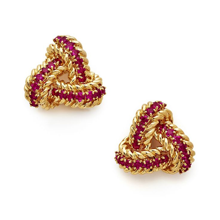 A pair of ruby and 18ct yellow gold trefoil rope twist knot earclips made circa 1980  Total weight of rubies 2.95 carats approximately  Overall diameter of earclips 2.5cms http://nigelmilne.co.uk/products/ruby-and-18ct-yellow-gold-trefoil-knot-earclips #Ruby #18ct #Yellow #Gold #Trefoil #Earclips #Earrings #Fine #Vintage #Antique #Jewellery #Buyer #Buying #Trip #America #Europe #London #Piccadilly #Nigel #Milne #rope #Twist
