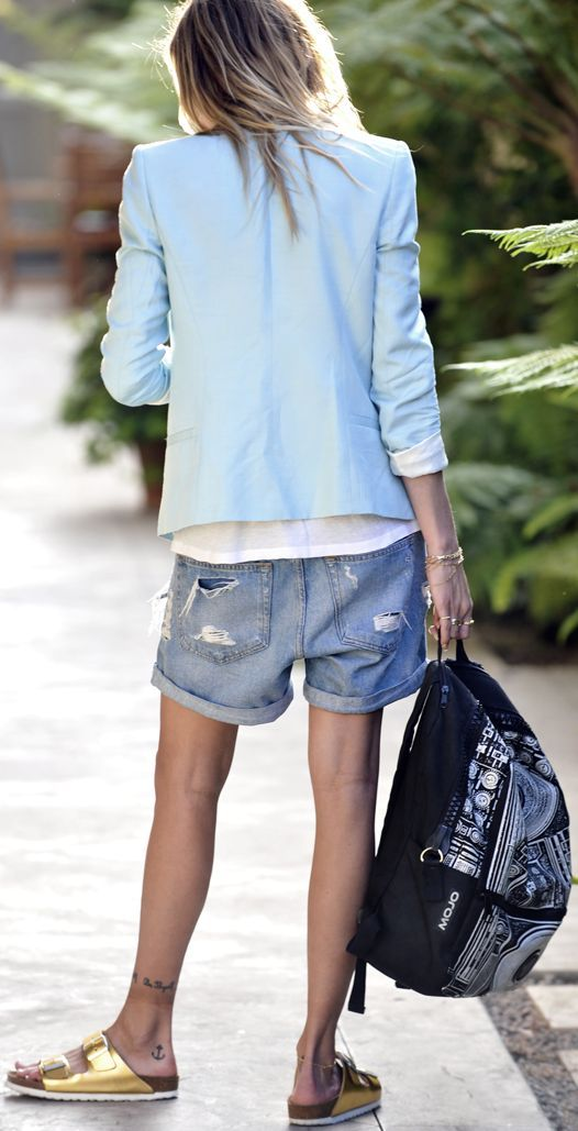 Shop this look on Lookastic:  http://lookastic.com/women/looks/blazer-crew-neck-t-shirt-shorts-flat-sandals-backpack/11128  — Light Blue Blazer  — White Crew-neck T-shirt  — Blue Ripped Denim Shorts  — Black and White Print Canvas Backpack  — Gold Leather Flat Sandals