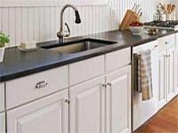 soapstone countertops with our white cabinets.  don't oil; let fade to more grey than black.
