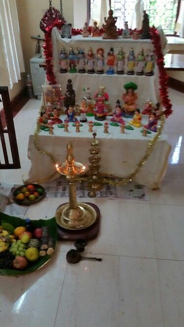 Pooja celebration. Display of Hindu gods and goddesses form part of the festival.