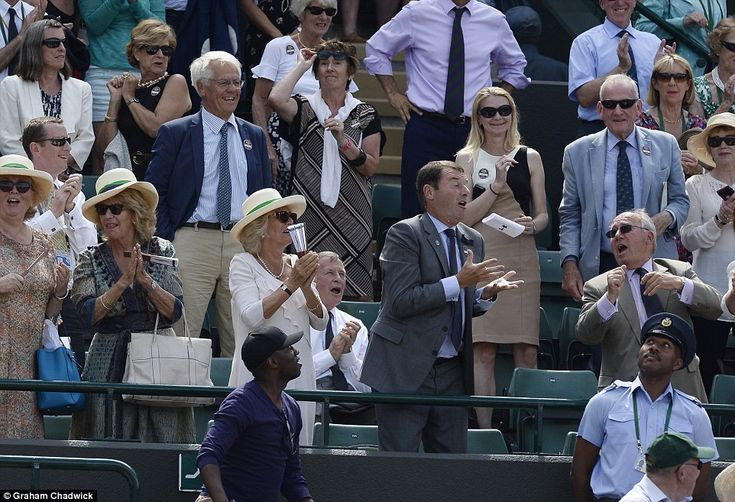 Andy Murray tosses his sweatband into the royal box at Wimbledon.