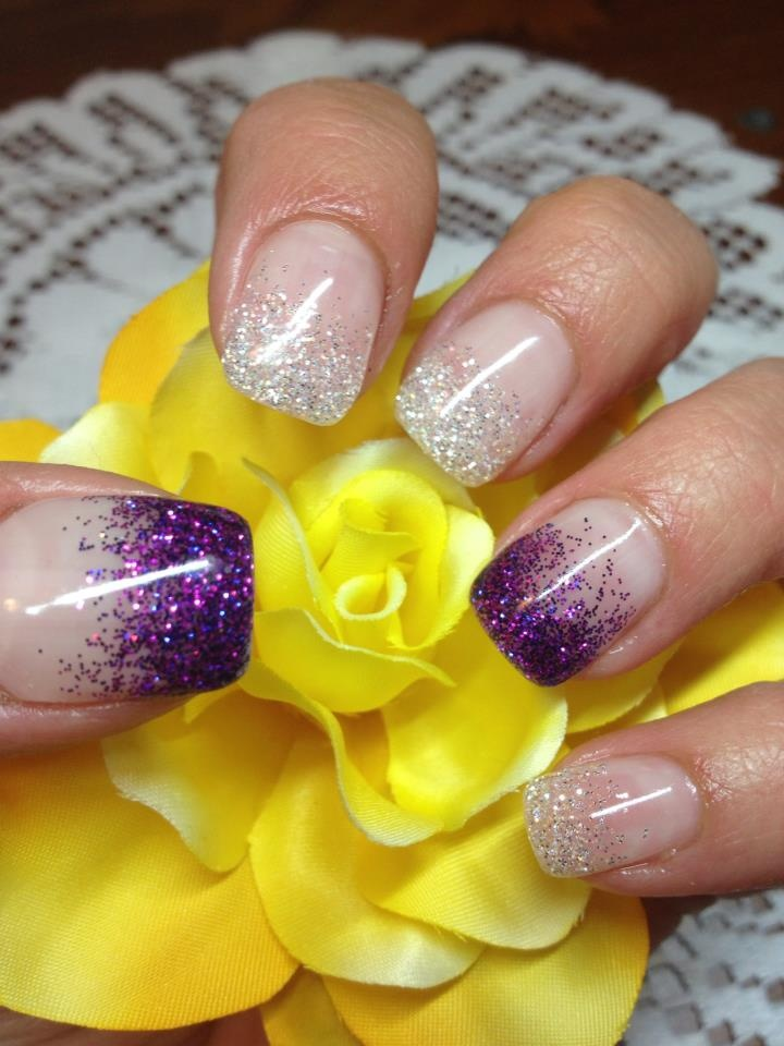 Sheer white base with white glitter tips; accent nails' glitter are purple.