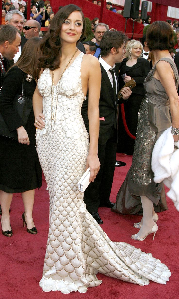 MARION COTILLARD, OSCAR 2008. The scales-like pattern on her Jean Paul Gaultier Couture gown gave her the effect of being a mermaid on land.