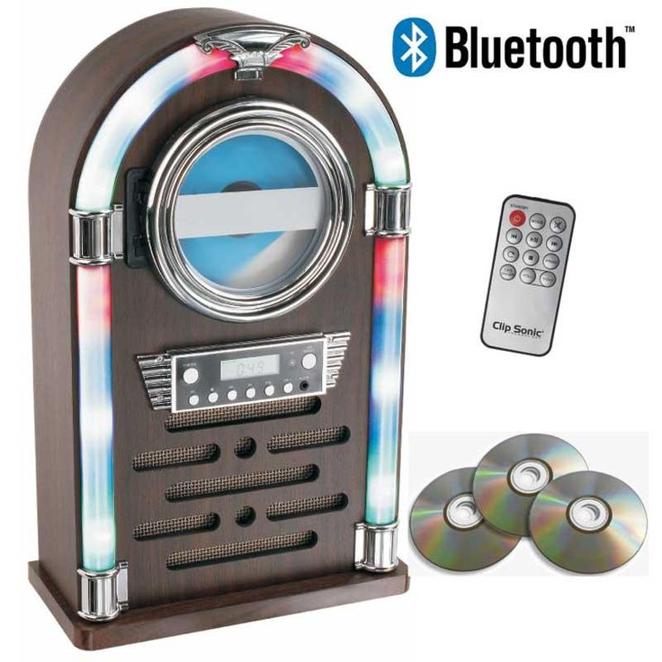 Jukebox compatible Bluetooth® Clipsonic TES195 - CD/CD-R/CD-RW/radio FM - Ahora tienes la oportunidad de disfrutar de la música en una original gramola con esta atractiva Jukebox de Clipsonic. Un diseño único con acabado en madera y luces al estilo de los años 60, que incorpora lector de CD / CD-R / CD-RW, radio FM. Toda la música que tengas en otros dispositivos Bluetooth® podrás reproducirla fácilmente en la Jukebox y escucharla con calidad , a través de sus altavoces. También podrás…