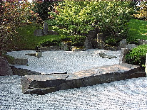 Zen Rock Garden ~ I love the clean, parallel lines of the 'water' & cut-stone steps of the 'mountain'!