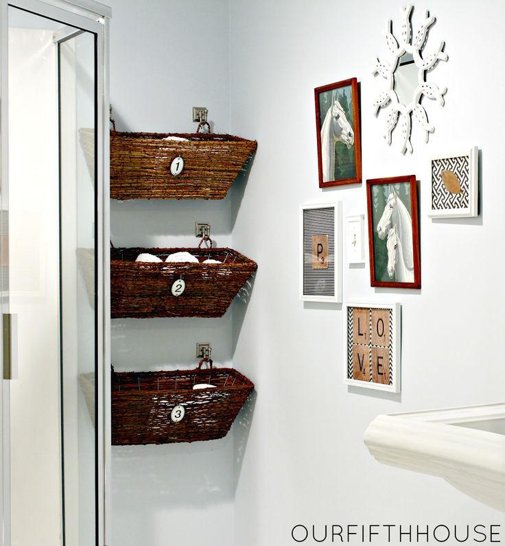 Uniform hanging baskets add polish and hide not-so-pretty bath items (we're looking at you, extra toilet paper). See more at Our Fifth House »  - GoodHousekeeping.com