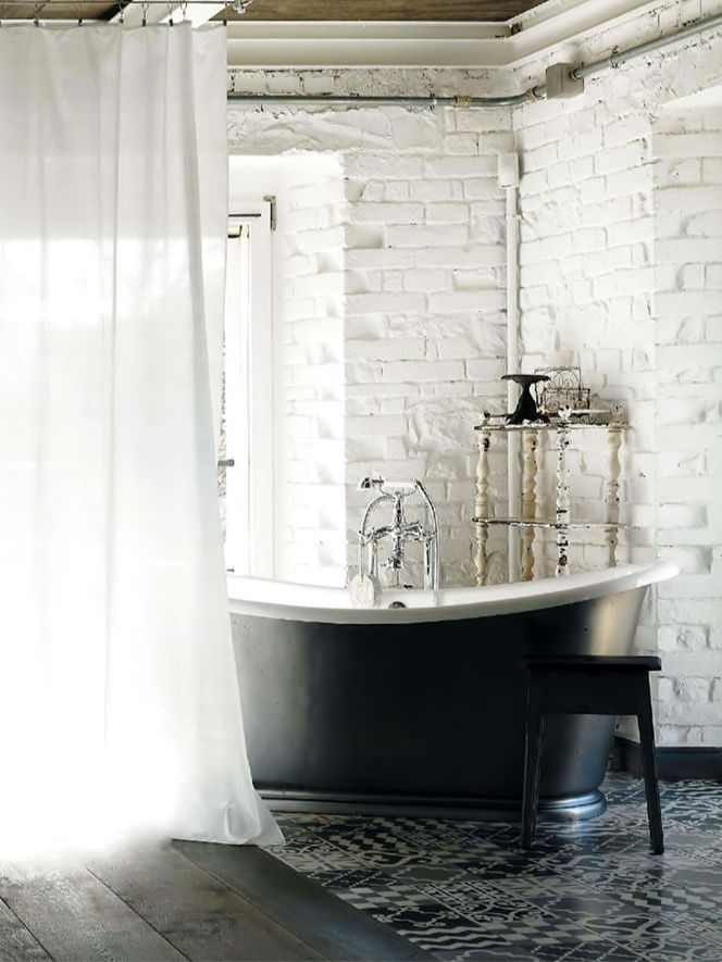exposed brick and cement tile floor bathroom