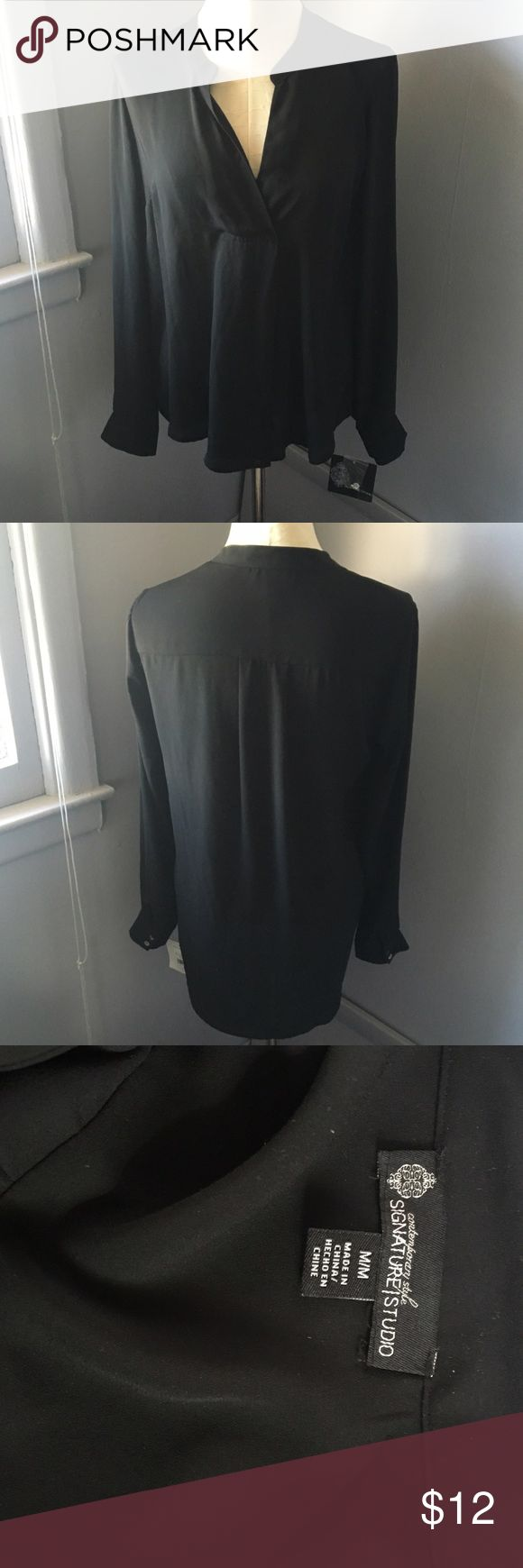 Black V Neck Blouse 100% polyester. Brand new with tags. From the department store Peebles . Sleeves can be cuffed up & button to be quarter length . Signature Studio Tops Blouses