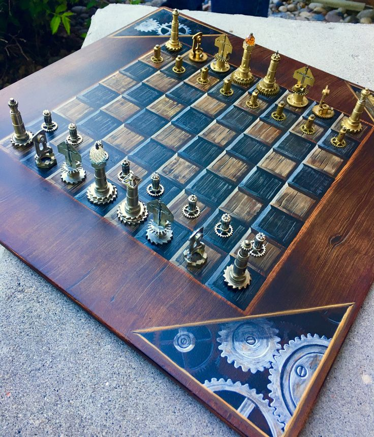 This is the centerpiece for any room, and the vessel for many great games of chess. Pieces are made out of the Clock (bronze) v the Industrial (silver). Board is a handpainted original by up-and-comin