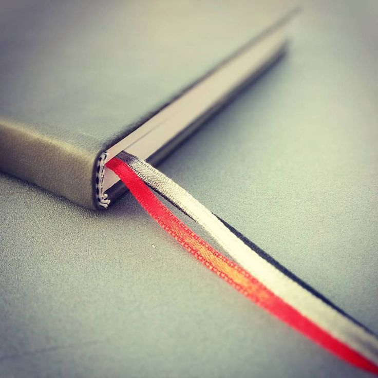 Three color ribbon bookmarks - red, grey, black