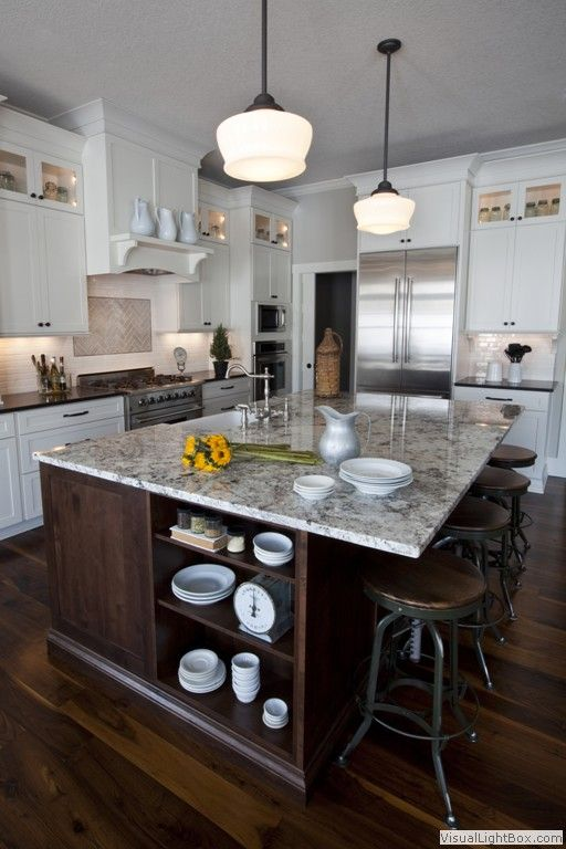 Modern country kitchen. Any way you can go with the dark cabinet and paint white cabinets to mix it up? Makes a big difference in keeping it light...dark wood floor, big pendants, cabinets to ceiling