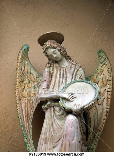 Sculpture of an angel with tambourine. Chiusi , Tuscany, Italy