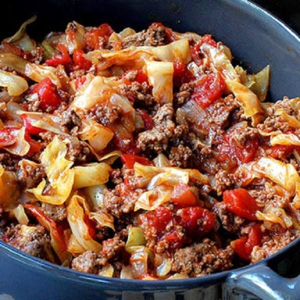 Ingredients: 1 1/2 to 2 pounds lean ground beef 1 tablespoon extra virgin olive oil 1 large onion, chopped 1 clove garlic, minced 1 small cabbage, chopped 2 cans (14.5 ounces each) low sodium diced
