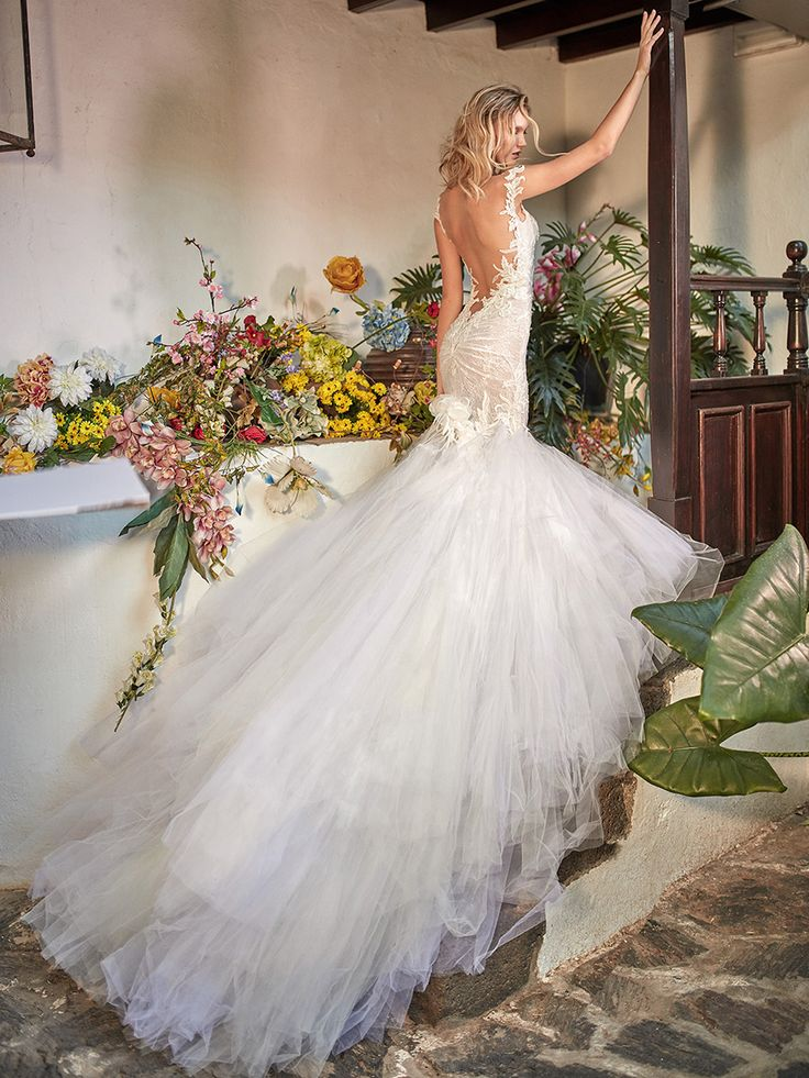 """""""Zenia"""", a french lace mermaid fit and flare dramatic gown with a low illusion back embroidered with large-scale appliques and accentuated with handmade silk flowers and a two-toned handkerchief skirt // Inspired by a bride's desire to express her individuality through a signature scent and wedding day style, Galia Lahav's Fall 2018 Florence by Night Couture Bridal Collection saw new approaches to gossamer tulle, fine lace and intri"""