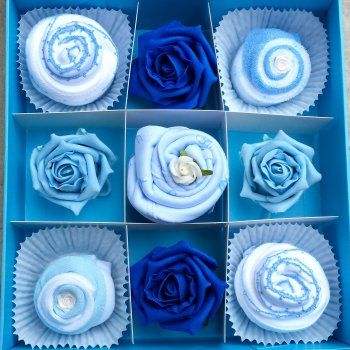 Cupcakes made from real baby clothes presented in a keepsake box. Perfect gift for newborn boys.