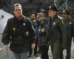 """Tommy Lee Jones as U.S. Marshal Sam Gerard and his team are looking to capture Dr. Kimble in """"The Fugitive"""""""