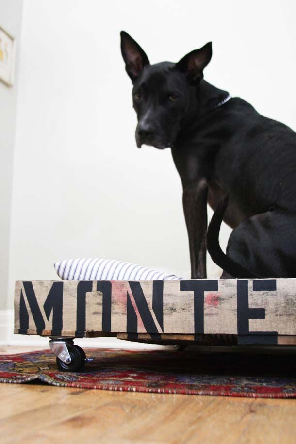 DIY DOG BED FOR BERNIE: Stenciled, industrial-chic dog bed made from reclaimed fence planks, spraypaint, stencils and casters. Michael Forbes to make. Let's white-wash the wood, and then let's stencil the letters with navy.