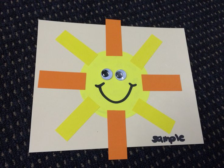 "Sunshine craft made by gluing a yellow ""kinder circle"" and paper strips onto paper and gluing on googly eyes."