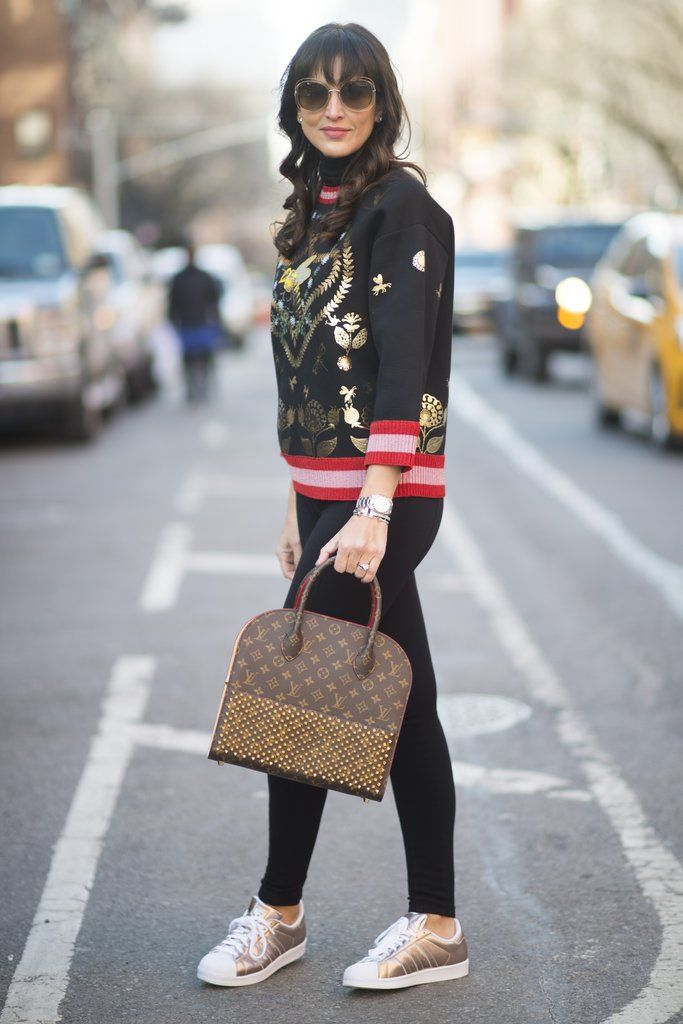 b3cb1818105 With an intricate sweater and metallic sneakers. Fashion Photo