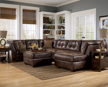 decorating with brown leather.  This needs a little color but I like the room.