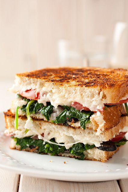 Mediterranean Grilled Cheese Sandwich - Mozzarella, feta, spinach, olives, basil, tomatoes and red onions. SO GOOD!!