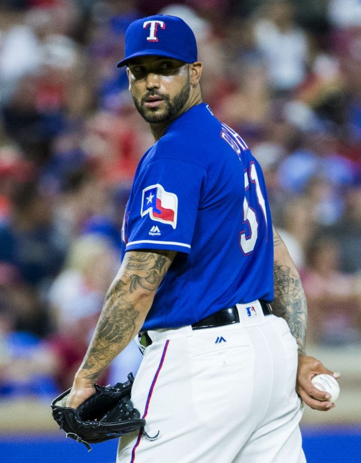 Texas Rangers relief pitcher Matt Bush (51) looks over his shoulder at first base during the seventh inning of their game against the Cincinnati Reds on Wednesday, June 22, 2016 Globe Life Park in Arlington, Texas. The Rangers won 6-4. (Ashley Landis/The Dallas Morning News)