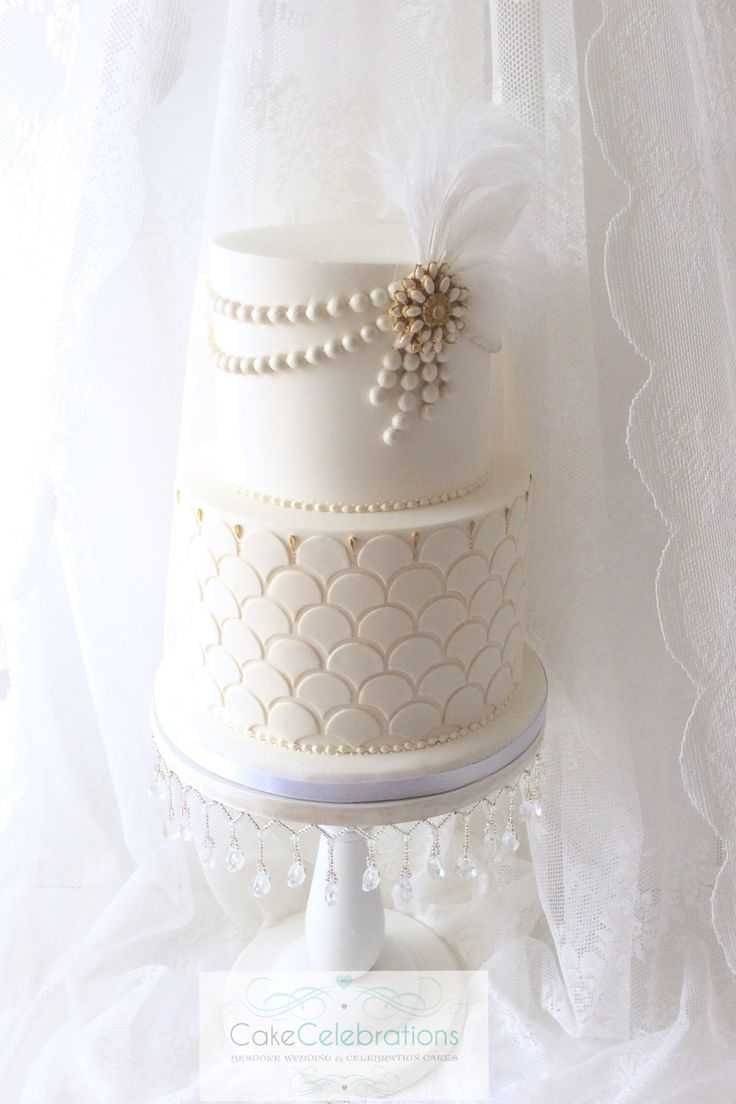 Art Deco wedding cake #weddingcake #wedding #feathers #cake #celebration #pearls #satin #somerset #somersetweddings #cakecelebrations #tieredcakes