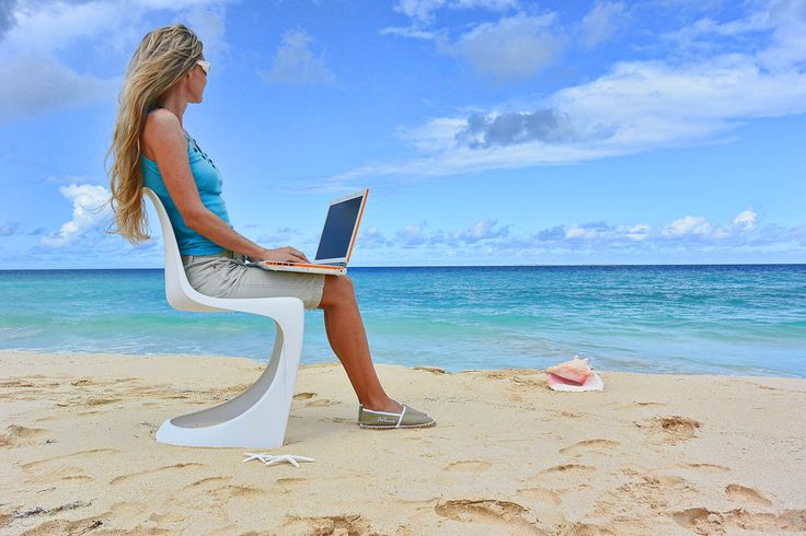 THE Dream office! How would you like this as your office? a white 290 Modo chair from Nielaus.dk designed by Steen Ostergaard.  Caribbean Beach office, Club Faniente, white sand, turquoise blue sea and pink seashells. Real Coastal living!