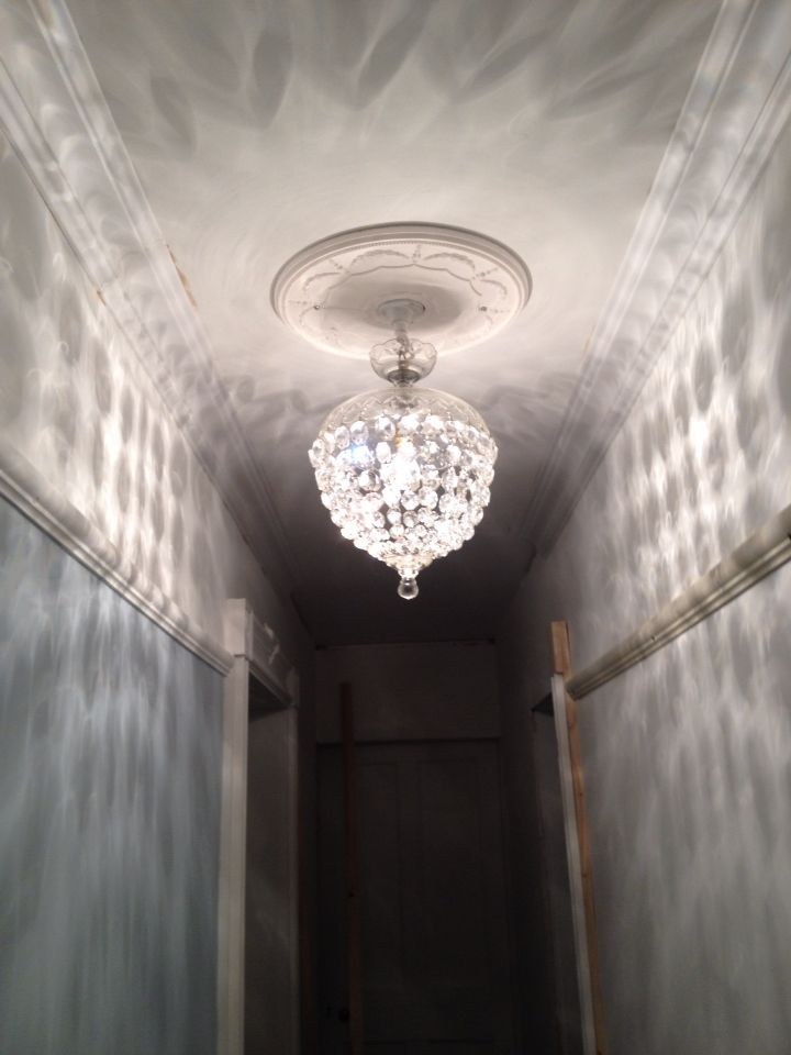 Coving and ceiling rose up along with light fitting