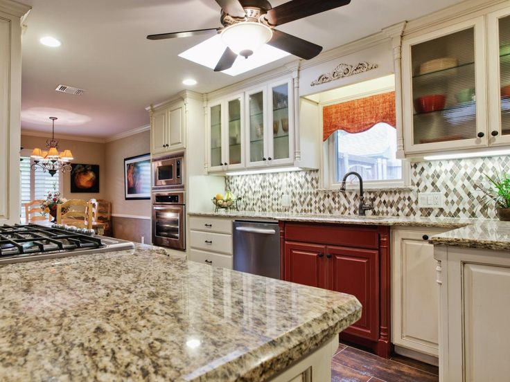 the contrasting sink cabinet adds a touch of color to this otherwise neutral kitchen choosing