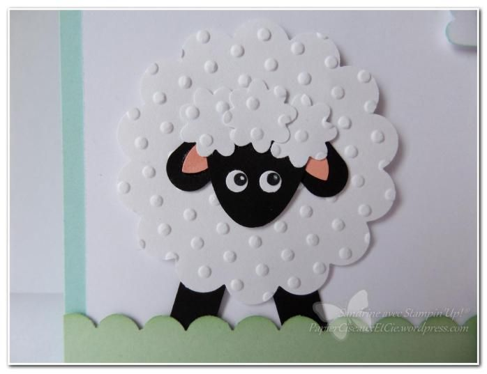 "By Sandrine. Sheep punch art. Cute!  Body: 2 1/2"" Scalloped Circle punch. Head: Large Oval punch. Fluff on head: smallest flower punch from Boho Blossom set. Ears and legs: Word Window punch. Inner ears: branch leaf from Bird Builder punch. Eyes: eyes from Owl Builder punch."