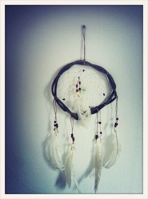 White Feather Hand made South American dream catcher. Keeps the bad dreams at the door.