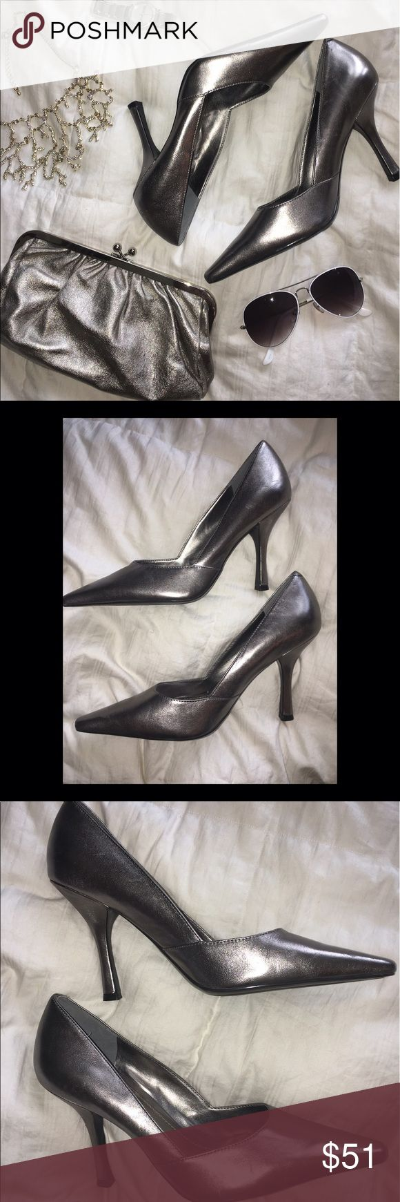 BCBGeneration Silver Grey High Heels These heels have never been worn. Close to perfect condition. They are a dark grey with a metallic effect that could be considered silver. They really are beautiful!! Pointed toe and stiletto heel. BCBGeneration Shoes Heels