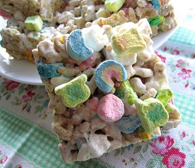 Lucky Charms Treats {same instructions as Rice Crispies, just add Lucky Charms instead, and then sprinkle a few marshmallows on top as they cool}
