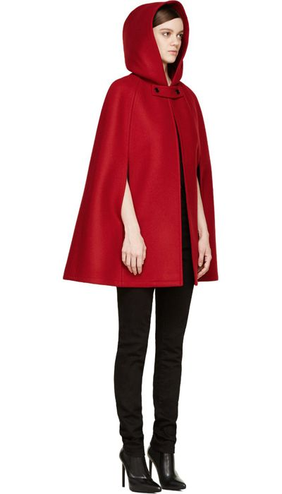 Red Hooded Wool Cape by Saint Laurent. Hooded wool cap in red. Throat guard with button fastening. Hook-eye closure at throat. Dropped armscye at front. Unlined. Tonal stitching. 100% wool. Made in Italy. http://www.zocko.com/z/JIukE