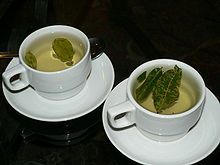 In La Paz, Bolivia, Cayetano drinks coca tea to clear his head from the altitude sickness.  Coca tea - Wikipedia, the free encyclopedia